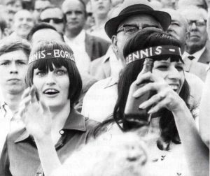 Two female fans of Tennis Borussia Berlin inside the stadium in the 1970s, shown on a black and white picture. One woman is holding a beer - Copyright: Archiv Tennis Borussia Berlin